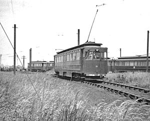 Grimsby and Immingham Electric Railway - Ex-GCR car 15, built in 1915, passes Pyewipe depot outbound for Immingham