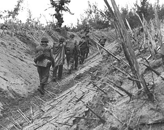 Operation Double Eagle - Company F, 2/4 Marines pass through a punji-staked gulley