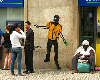 """Tavar Zawacki - """"Giving to the poor"""" stencil in Lisbon, Portugal, addressing the issue of homelessness"""