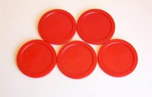 Air hockey - A group of five air hockey pucks