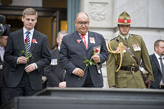 Bill English - English (left) at a 2011 Anzac Day service in Wellington, alongside then-Governor-General Sir Anand Satyanand (centre)
