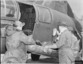 AT FRONT LINES IN KOREA - Tragedy is again by-passed as another fallen UN soldier receives blood plasma while being... - NARA - 542235.tif