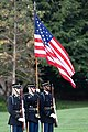 A Flag Detail stands at attention during a moment of silence on the South Lawn (48717510773).jpg