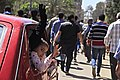 A girl and a woman wave from the window of their car during a protest in Cairo - 28-Mar-2014.jpg