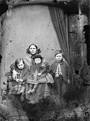 A group of one woman and three children
