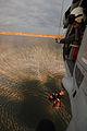 A naval aircrewman hoists Sailors nto a MH-60S Sea Hawk helicopter 130228-N-LY640-156.jpg