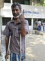 A physically challenged voter showing indelible ink after casting his vote, at a polling booth, during the fourth phase of West Bengal Assembly Election, at Baltikuri, Kalitala, district Howrah on April 25, 2016.jpg