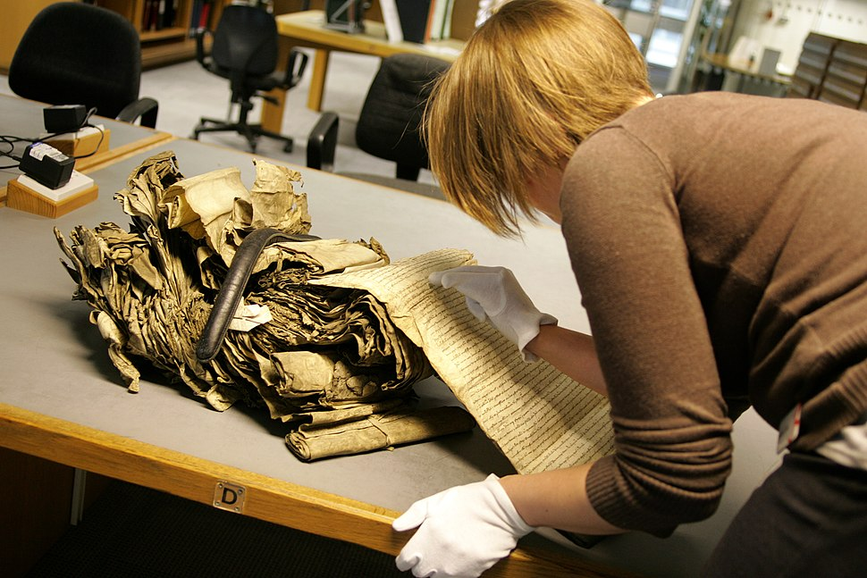 A researcher working with delicate resource at The National Archives