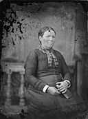 A woman sitting and holding a book NLW3364896.jpg