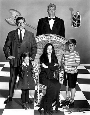 The Addams Family (1964 TV series) - The main cast: Gomez (John Astin), Lurch (Ted Cassidy), Wednesday (Lisa Loring), Morticia (Carolyn Jones), and Pugsley (Ken Weatherwax).