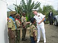 Adm. Walsh presents his personal coin to a Solomon Island Scout at the Guadacanal Monument (5885986795).jpg