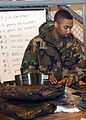 Airman First Class (A1C) Jerome Spears, a member of the 31st Supply Squadron (SS), Aviano Air Base, Italy, checks the contents of a standard 'C' bag, used for chemical warfare protection, during a recent 020114-F-NY901-007.jpg
