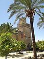 Alcázar de los Reyes Cristianos - Calle Cabellerizas Reales, Cordoba - Tower of the Lions - palm tree (14571620469).jpg