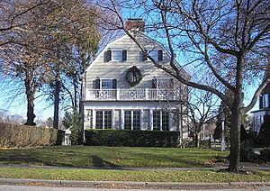 Amityville, New York - The Amityville Horror house in December 2005. The house's signature quarter moon windows on the top floor were replaced in 1990.