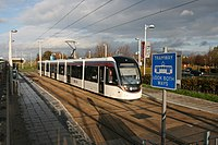 An Edinburgh Tram at Gyle Centre tramstop (geograph 4241542).jpg