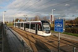 An Edinburgh Tram at Gyle Centre tramstop (geograph 4241542).jpg