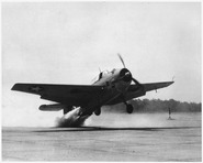 An airplane taking off with the aid of 330 horsepower jet-assisted unit in about half the normal run. - NARA - 295602