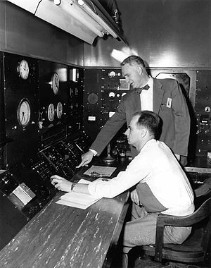 Walter Zinn - Zinn (standing) presses the button that closes down the Chicago Pile-3 unit for good.