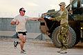 Australian Army Capt. Travis Hoffman, left, participates in the Sand to Sand charity run at Multinational Base Tarin Kowt, Uruzgan province, Afghanistan, Aug. 17, 2013 130817-O-MD709-086-AU.jpg