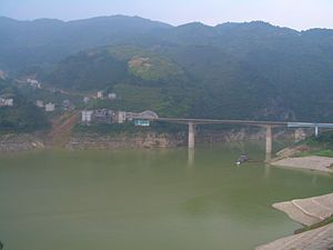 Three Gorges Reservoir Region - Formerly shallow Shen Nong Stream made into a major river, as it falls into the Yangtze near Badong