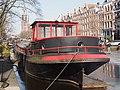 Barge als woonboot op de Prinsengracht.jpg