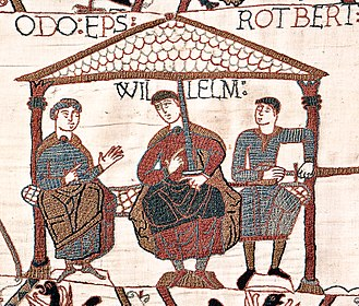 William the Conqueror - Image from the Bayeux Tapestry showing William with his half-brothers. William is in the centre, Odo is on the left with empty hands, and Robert is on the right with a sword in his hand.