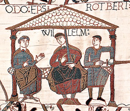Image from the Bayeux Tapestry showing William with his half-brothers. William is in the centre, Odo is on the left with empty hands, and Robert is on the right with a sword in his hand. Bayeuxtapestryodowilliamrobert.jpg