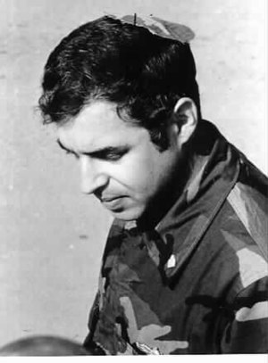 "Kippah - Chaplain Arnold Resnicoff, wearing the makeshift ""camouflage kippah"" made for him by Catholic chaplain (Rev.) George Pucciarelli, after his Kippah became bloodied when it was used to wipe the face of a wounded Marine, Beirut, 1983"