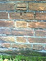 Benchmark on wall at SW side of High Street - geograph.org.uk - 2145916.jpg