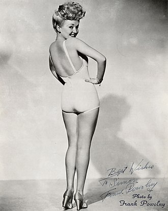 "Betty Grable - Grable's iconic pose from 1943 was a World War II bestseller, showing off her ""Million Dollar Legs""."