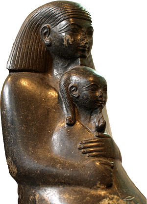 Neferure - Block statue of the courtier Senenmut holding the princess Neferure in his arms, on display at the British Museum