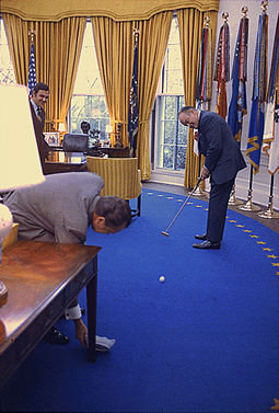 Hope, a golf fan, putting a golf ball into an ashtray held by President Richard Nixon in the Oval Office in 1973 Bob Hope playing golf in the Oval Office.png