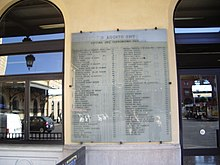 Large plaque with the names and ages of the victims