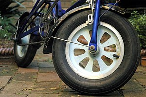 Bootie (bicycle) - Original type 62 x 203 Michelin balloon tire on front wheel of Bootie Folding Cycle
