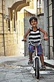Boy on a bicycle in the narrow streets of the old city.JPG