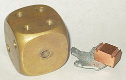 A decorative brass paperweight, left, along with zinc and copper samples.