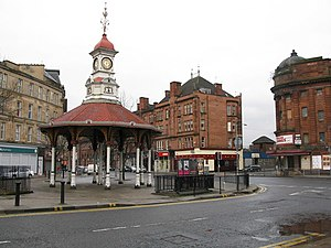 Bridgeton, Glasgow - Bridgeton Cross with the Umbrella, former station building (background) and Olympia theatre (right) prior to renovation work.
