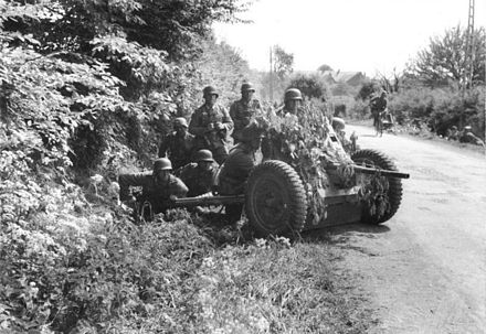 German infantry with a Pak 36 anti-tank gun in western Belgium in May 1940. Bundesarchiv Bild 101I-127-0391-21, Im Westen, deutsche Soldaten mit getarnter Pak.jpg