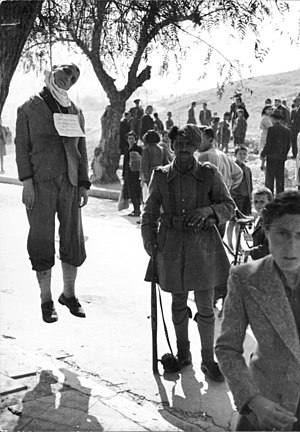 Greek Civil War - A member of the Security Battalions with a man executed for aiding the Resistance.