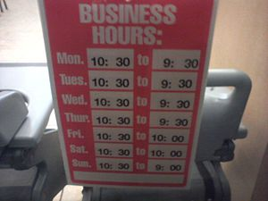Business hours - A sign posted on a window at a Baja Fresh restaurant in the U.S. state of Maryland, listing the seven days of the week and their associated hours of operation for the establishment.