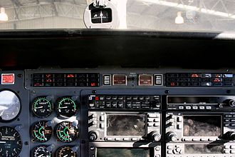 Annunciator panel - The annunciator panel of a Cessna 441 aircraft. The illuminated process annunciators are those that are normally lit when the engines are not running, plus one annunciating that the aircraft's door is not locked
