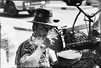 Kretek - A becak driver in Yogyakarta, Indonesia, smoking a kretek