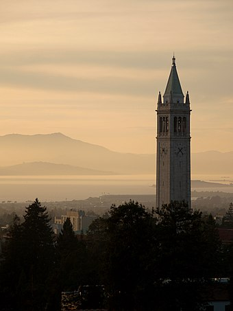 Sather Tower (the Campanile) looking out over the San Francisco Bay with Mount Tamalpais in the distance, from California Memorial Stadium at sunset, 2006.