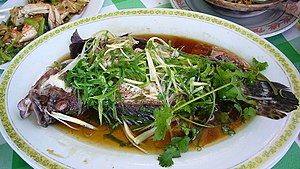 Steaming - Cantonese cuisine, steamed fish, seasoned with soy sauce, coriander and Welsh onion