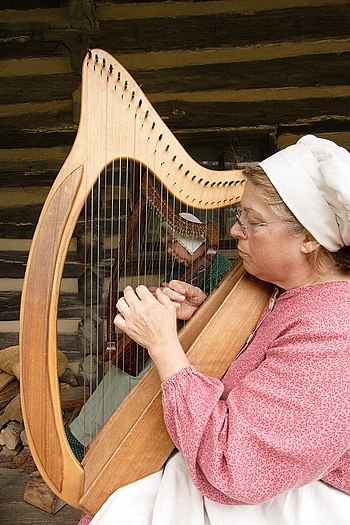 New Salem Village re-enactors playing Celtic harps