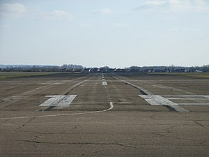Chalgrove Airfield - Chalgrove Airfield, looking southwards down the length of one of the runways with Chalgrove village behind.