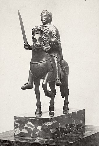 The Carolingian-era equestrian statuette thought to represent Charlemagne (from Metz Cathedral, now in the Louvre) Charles Marville, Hotel Carnavalet, statue of Charlemagne, ca. 1853-70.jpg