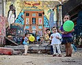 Children playing in the colored city of Alberusw.jpg