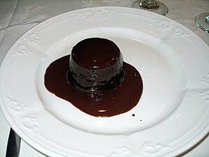 Molten chocolate cake - Chocolate lava cake smothered in chocolate sauce