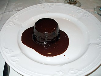 Molten chocolate cake - Chocolate lava cake smothered in chocolate sauce